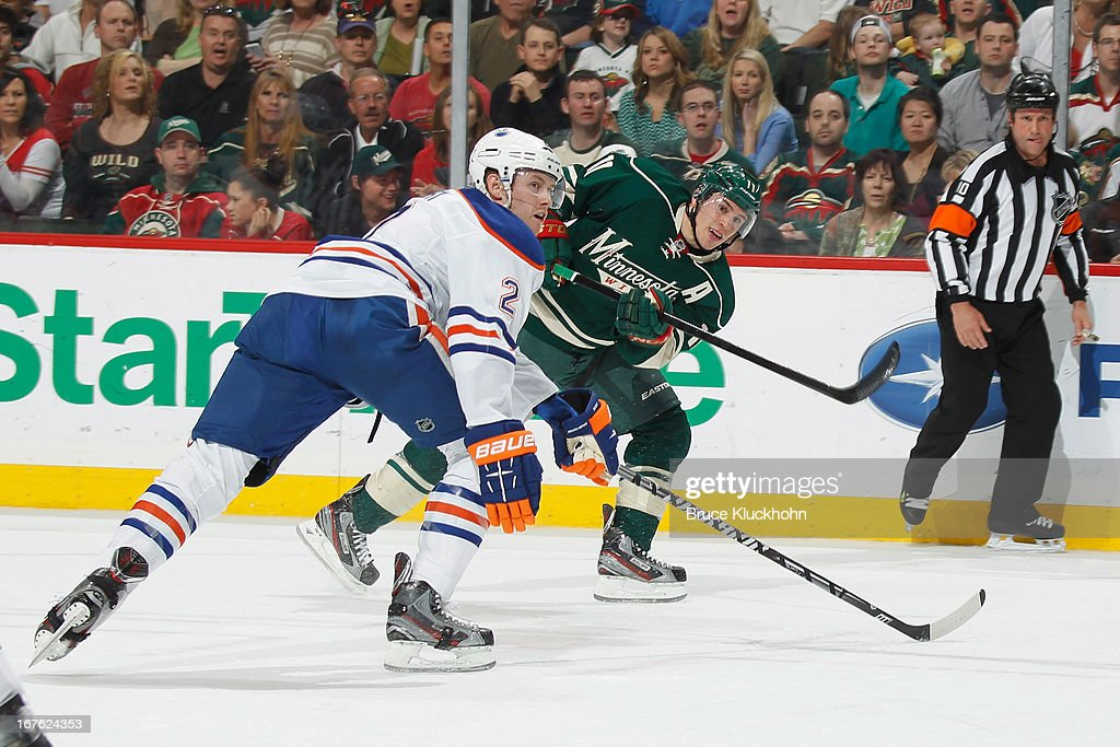 <a gi-track='captionPersonalityLinkClicked' href=/galleries/search?phrase=Zach+Parise&family=editorial&specificpeople=213606 ng-click='$event.stopPropagation()'>Zach Parise</a> #11 of the Minnesota Wild shoots with <a gi-track='captionPersonalityLinkClicked' href=/galleries/search?phrase=Jeff+Petry&family=editorial&specificpeople=570439 ng-click='$event.stopPropagation()'>Jeff Petry</a> #2 of the Edmonton Oilers defending during the game on April 26, 2013 at the Xcel Energy Center in St. Paul, Minnesota.