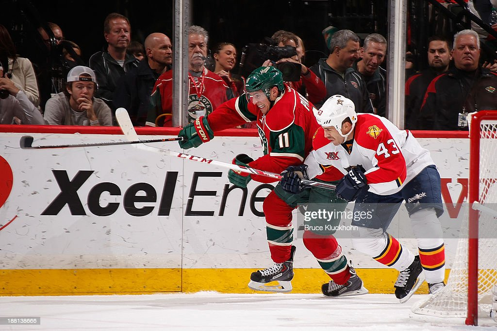 <a gi-track='captionPersonalityLinkClicked' href=/galleries/search?phrase=Zach+Parise&family=editorial&specificpeople=213606 ng-click='$event.stopPropagation()'>Zach Parise</a> #11 of the Minnesota Wild skates against Mike Weaver #43 of the Florida Panthers during the second period game on November 15, 2013 at the Xcel Energy Center in St. Paul, Minnesota.