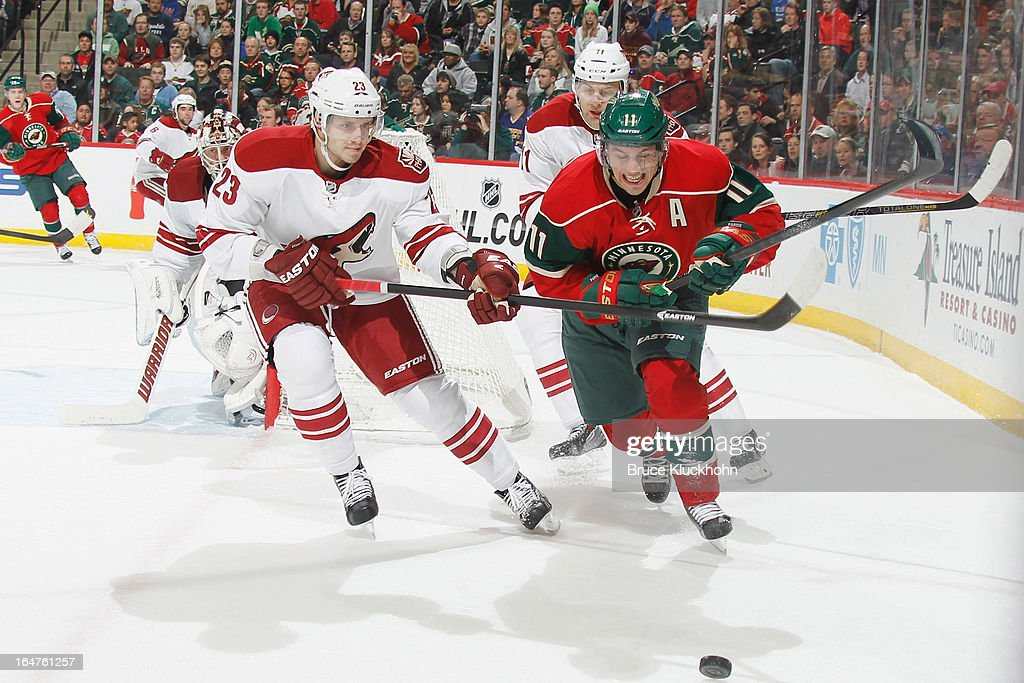 Zach Parise #11 of the Minnesota Wild skates to puck with (L-R) Oliver Ekman-Larsson #23 and Martin Hanzal #11 of the Phoenix Coyotes defending during the game on March 27, 2013 at the Xcel Energy Center in Saint Paul, Minnesota.