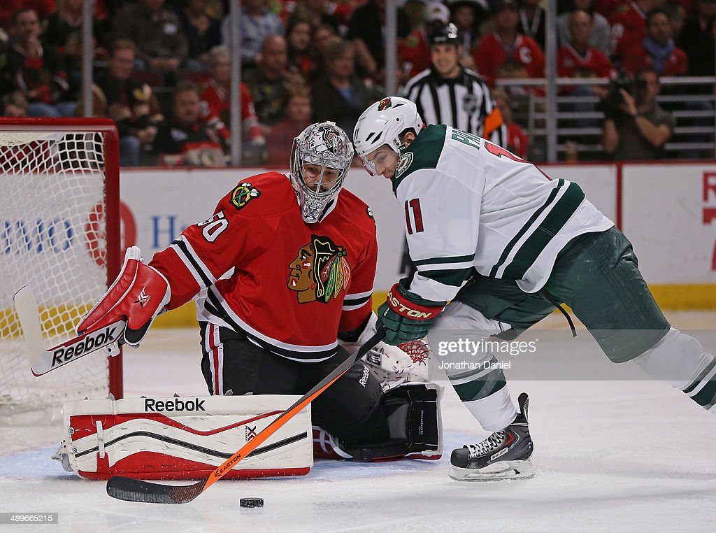 Zach Parise #11 of the Minnesota Wild tries to get off a shot against Corey Crawford #50 of the Chicago Blackhawks in Game Five of the Second Round of the 2014 NHL Stanley Cup Playoffs at the United Center on May 11, 2014 in Chicago, Illinois.