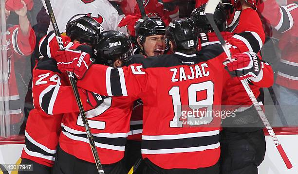 Zach Parise of the New Jersey Devils is congratulated by his teammates after scoring a first period goal against the Florida Panthers in Game Three...