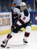 Zach Parise of the New Jersey Devils looks to make a play against the New York Islanders during their NHL pre season game on September 30 2006 at the...