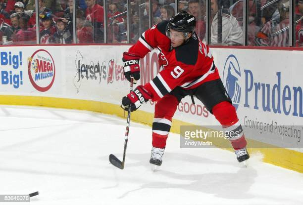 Zach Parise of the New Jersey Devils passes the puck against the Edmonton Oilers at the Prudential Center on November 9 2008 in Newark New Jersey