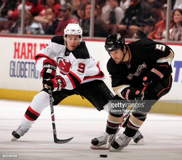 Zach Parise of the New Jersey Devils reaches in for the puck against Steve Montador of the Anaheim Ducks during the game on January 11 2009 at Honda...
