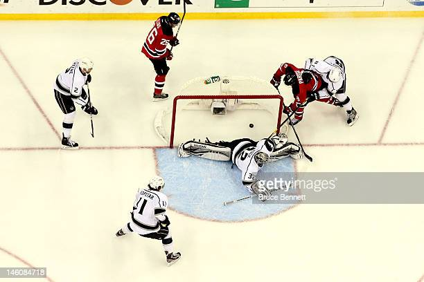 Zach Parise of the New Jersey Devils scores a goal against Jonathan Quick of the Los Angeles Kings in the first period as Matt Greene Patrik Elias...