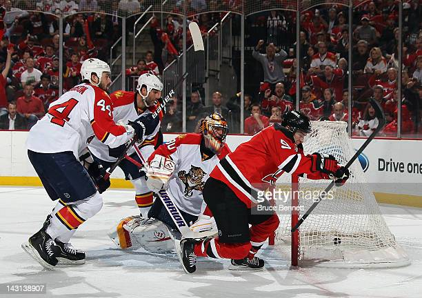 Zach Parise of the New Jersey Devils scores a powerplay goal at 608 of the second period against Scott Clemmensen of the Florida Panthers in Game...