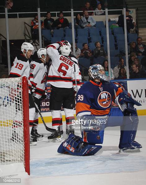Zach Parise of the New Jersey Devils scores at 1306 of the first period against Rick DiPietro of the New York Islanders at the Nassau Veterans...