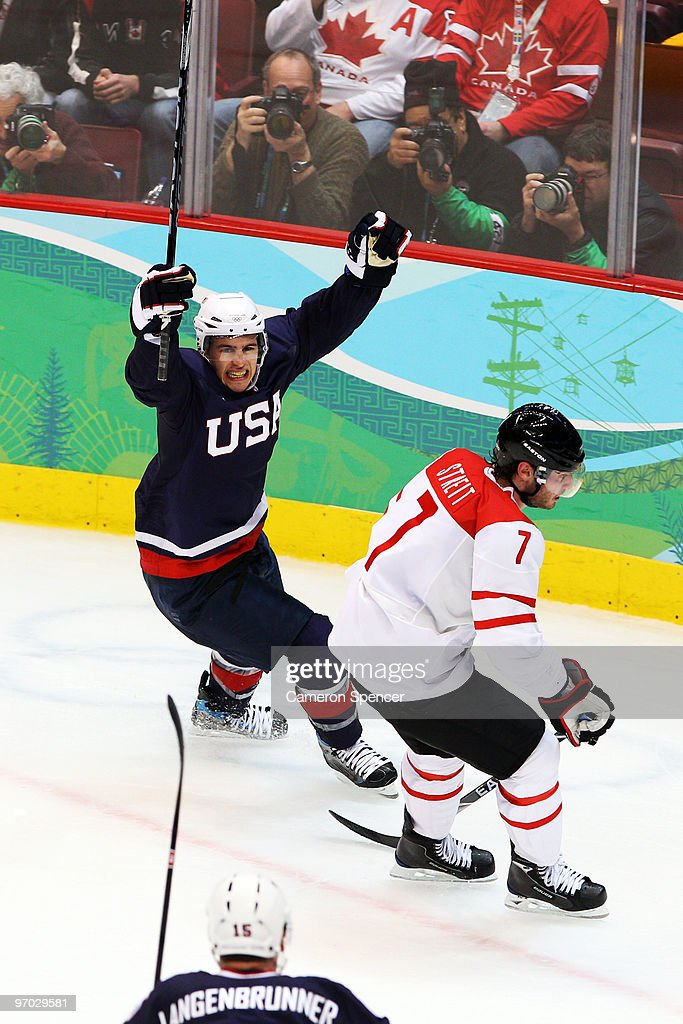 Zach Parise of the United States celebrate after a late goal in front of Mark Streit of Switzerland during ice hockey men's quarter final game...