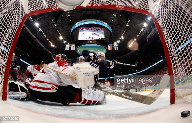 Zach Parise of the United States celebrates after scoring a goal past Roberto Luongo of Canada to tie the scores 22 late in the third during the ice...