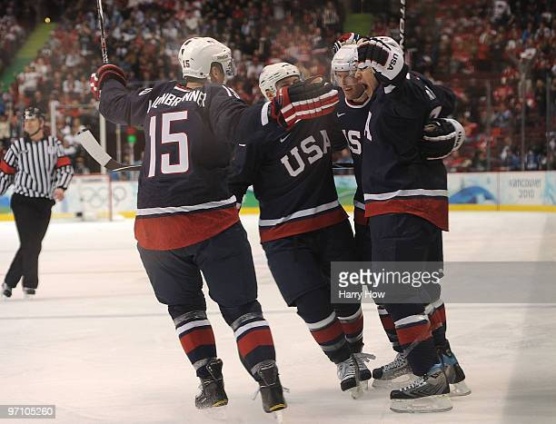 Zach Parise of the United States celebrates with his team mates after he scored past goalkeeper Miikka Kiprusoff of Finland during the ice hockey...