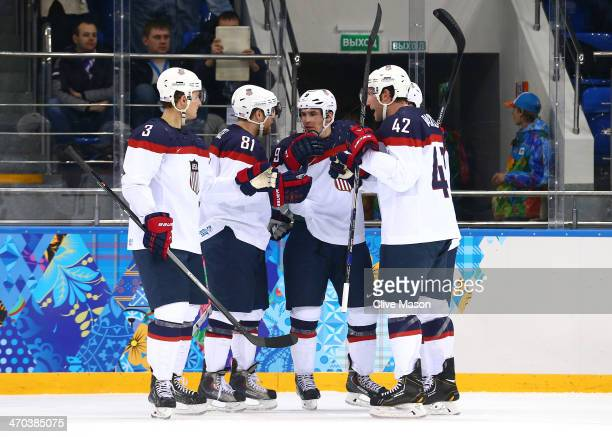 Zach Parise of the United States celebrates with teammates after scoring his team's fourth goal in the second period against Ondrej Pavelec of the...