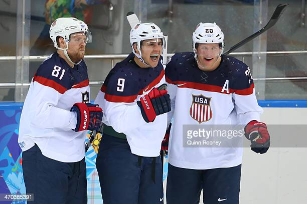 Zach Parise of the United States celebrates with teammates Phil Kessel of the United States and Ryan Suter of the United States after scoring his...