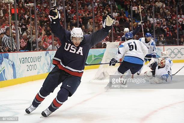 Zach Parise of the United States celebrating scoring past goalkeeper Miikka Kiprusoff of Finland during the ice hockey men's semifinal game between...