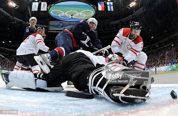 Zach Parise of the United States scores a goal past Jonas Hiller of Switzerland in the third period during the ice hockey men's quarter final game...