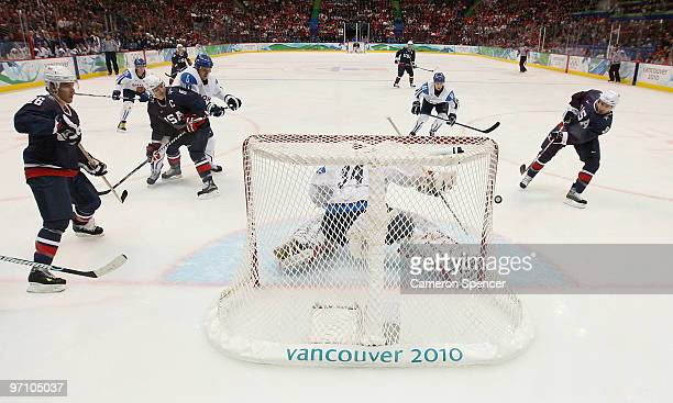 Zach Parise of the United States scores past goalkeeper Miikka Kiprusoff of Finland during the ice hockey men's semifinal game between the United...