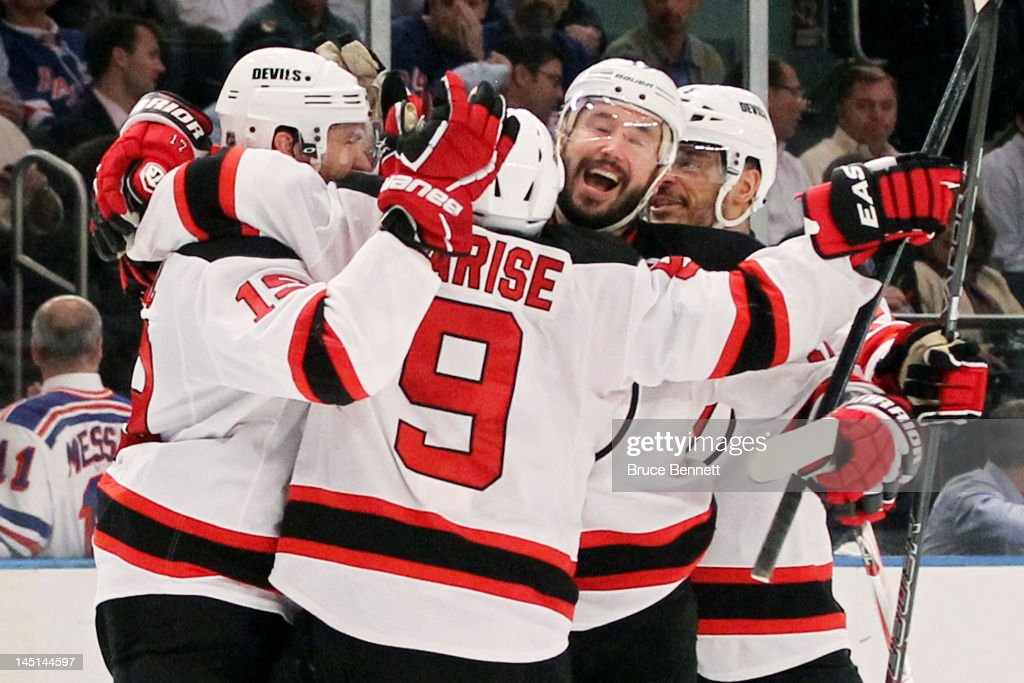 <a gi-track='captionPersonalityLinkClicked' href=/galleries/search?phrase=Zach+Parise&family=editorial&specificpeople=213606 ng-click='$event.stopPropagation()'>Zach Parise</a> #9, <a gi-track='captionPersonalityLinkClicked' href=/galleries/search?phrase=Travis+Zajac&family=editorial&specificpeople=864182 ng-click='$event.stopPropagation()'>Travis Zajac</a> #19, <a gi-track='captionPersonalityLinkClicked' href=/galleries/search?phrase=Ilya+Kovalchuk&family=editorial&specificpeople=201796 ng-click='$event.stopPropagation()'>Ilya Kovalchuk</a> #17 and <a gi-track='captionPersonalityLinkClicked' href=/galleries/search?phrase=Bryce+Salvador&family=editorial&specificpeople=208746 ng-click='$event.stopPropagation()'>Bryce Salvador</a> #24 of the New Jersey Devils celebrate their 5 to3 win over the New York Rangers in Game Five of the Eastern Conference Final during the 2012 NHL Stanley Cup Playoffs at Madison Square Garden on May 23, 2012 in New York City.