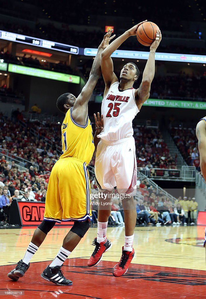 Zach Price #25 of the Louisville Cardinals shoots the ball while defended by Fred Chatmon #21 of the Missouri-Kansas City Kangaroos during the game at KFC YUM! Center on December 8, 2012 in Louisville, Kentucky.