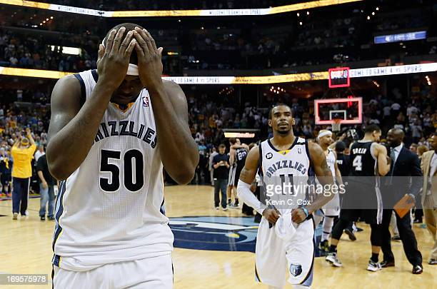 Zach Randolph and Mike Conley of the Memphis Grizzlies react after losing to the San Antonio Spurs 9386 during Game Four of the Western Conference...
