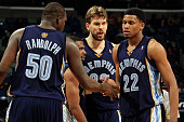 Zach Randolph Mike Conley Marc Gasol congratulate Rudy Gay of the Memphis Grizzlies after picking up a loose ball against the New Orleans Hornets at...
