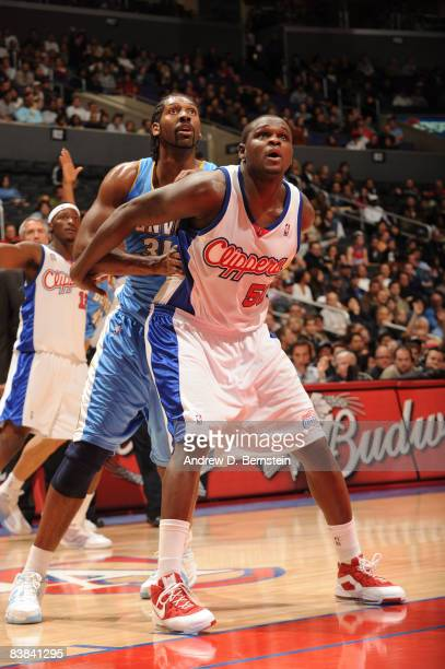 Zach Randolph of the Los Angeles Clippers boxes out against Nene of the Denver Nuggets at Staples Center on November 26 2008 in Los Angeles...