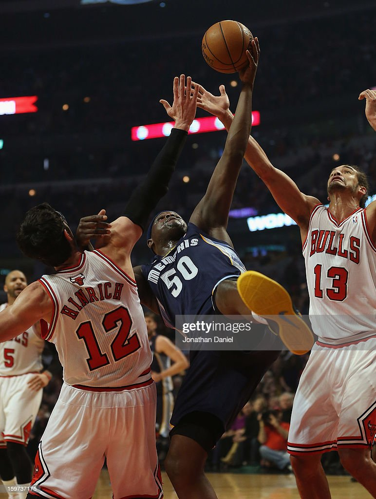 Zach Randolph #50 of the Memphis Grizzles tries to rebound between Kirk Hinrich #12 and Joakim Noah #13 of the Chicago Bulls at the United Center on January 19, 2013 in Chicago, Illinois.