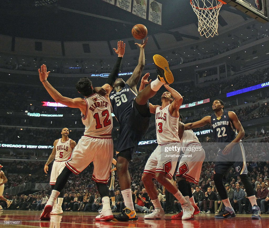 Zach Randolph #50 of the Memphis Grizzles tries to rebound between Kirk Hinrich #12 and Joakim Noah #13 of the Chicago Bulls at the United Center on January 19, 2013 in Chicago, Illinois. The Grizzles defeated the Bulls 85-82 in overtime.