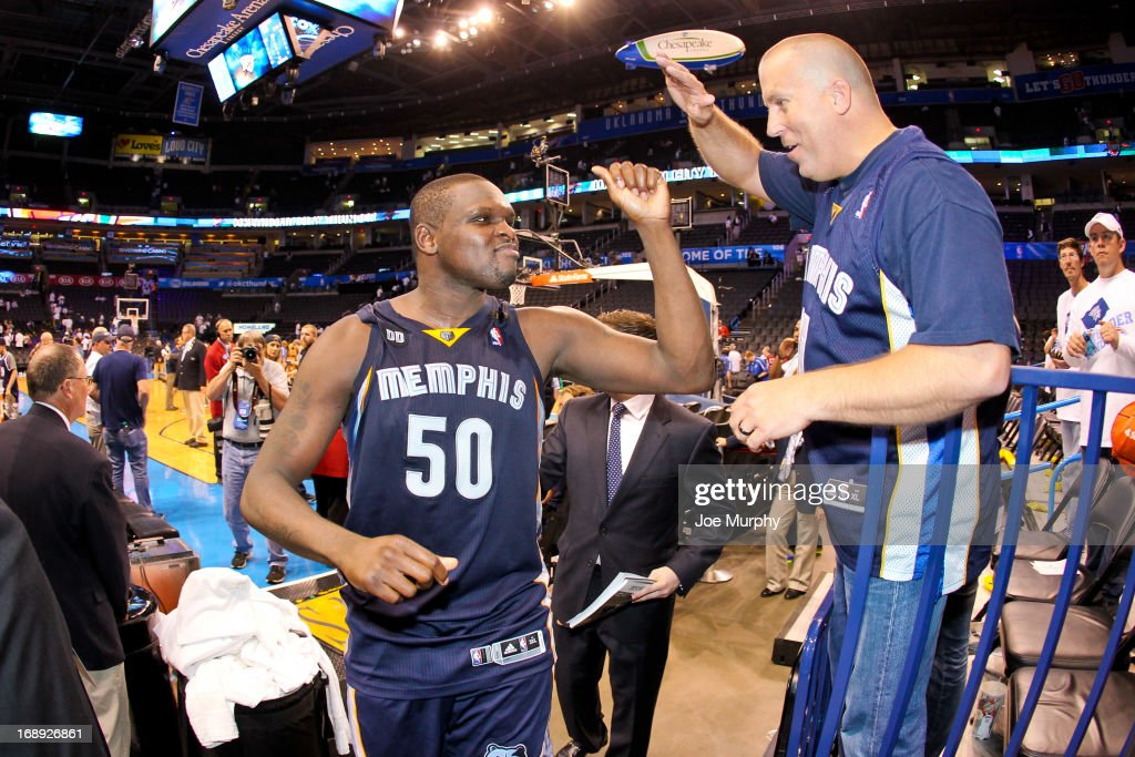 <a gi-track='captionPersonalityLinkClicked' href=/galleries/search?phrase=Zach+Randolph&family=editorial&specificpeople=201595 ng-click='$event.stopPropagation()'>Zach Randolph</a> #50 of the Memphis Grizzlies celebrates with a fan following his team's series victory against the Oklahoma City Thunder in Game Five of the Western Conference Semifinals during the 2013 NBA Playoffs on May 15, 2013 at the Chesapeake Energy Arena in Oklahoma City, Oklahoma.