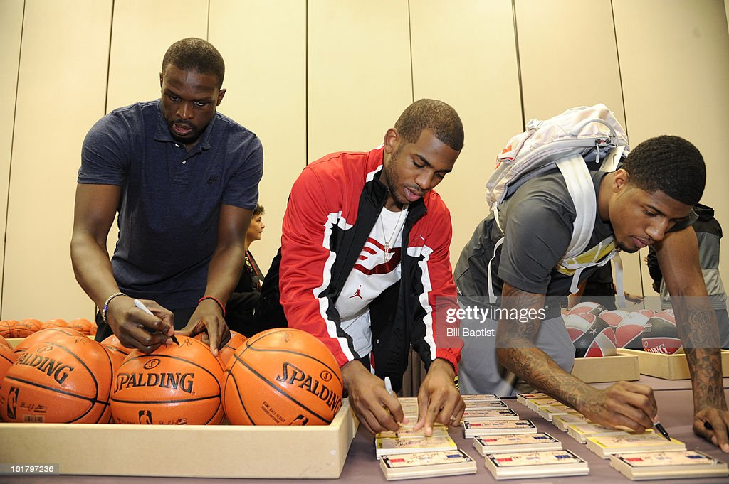 Zach Randolph #50 of the Memphis Grizzlies, Chris Paul #3 of the Los Angeles Clippers and Paul George #24 of the Indiana Pacers autograph balls before the NBA All-Star Practice in Sprint Arena at Jam Session during the NBA All-Star Weekend on February 16, 2013 at the George R. Brown Convention Center in Houston, Texas.