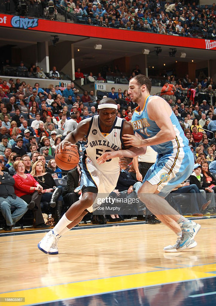 Zach Randolph #50 of the Memphis Grizzlies drives against Kosta Koufos #41 of the Denver Nuggets on December 29, 2012 at FedExForum in Memphis, Tennessee.