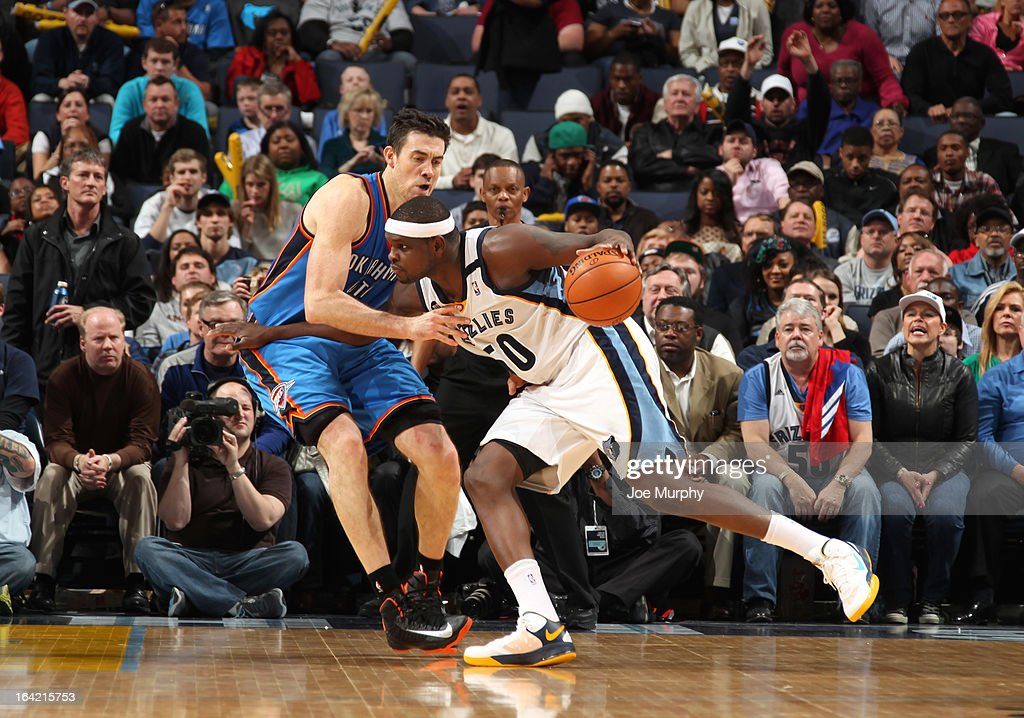 <a gi-track='captionPersonalityLinkClicked' href=/galleries/search?phrase=Zach+Randolph&family=editorial&specificpeople=201595 ng-click='$event.stopPropagation()'>Zach Randolph</a> #50 of the Memphis Grizzlies drives against <a gi-track='captionPersonalityLinkClicked' href=/galleries/search?phrase=Nick+Collison&family=editorial&specificpeople=202843 ng-click='$event.stopPropagation()'>Nick Collison</a> #4 of the Oklahoma City Thunder on March 20, 2013 at FedExForum in Memphis, Tennessee.