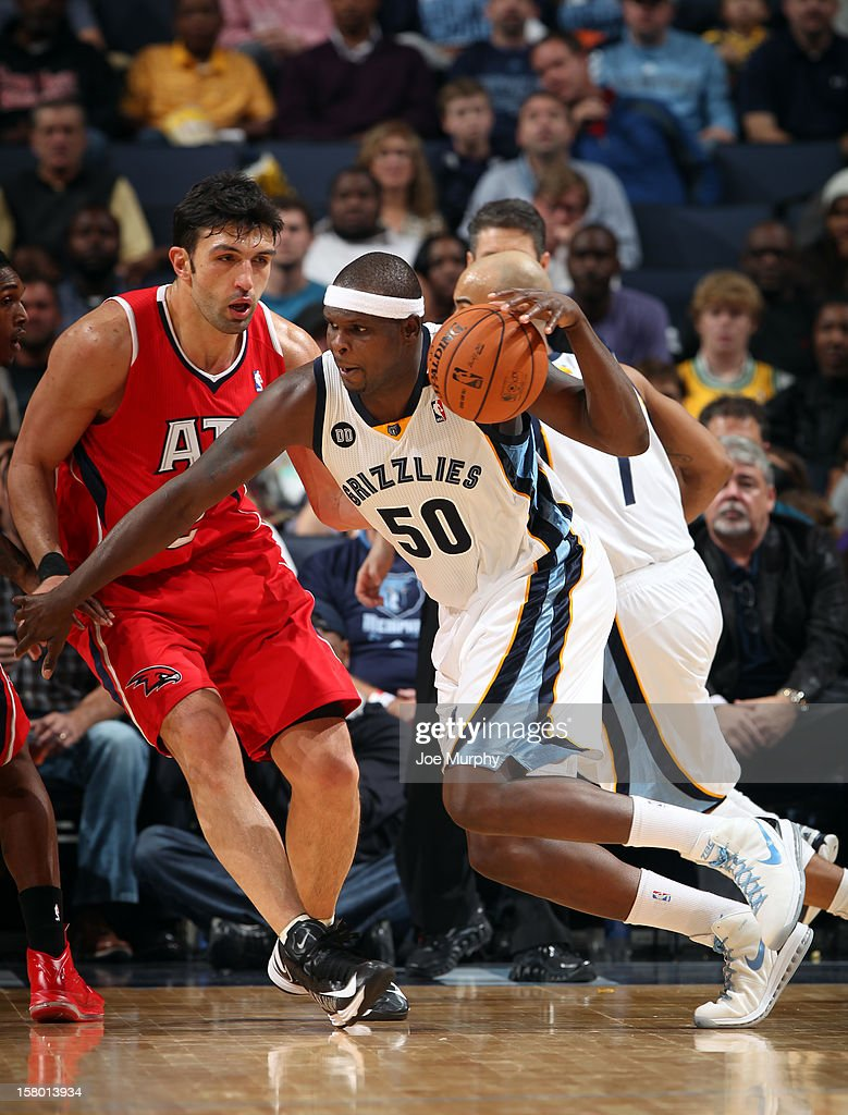 <a gi-track='captionPersonalityLinkClicked' href=/galleries/search?phrase=Zach+Randolph&family=editorial&specificpeople=201595 ng-click='$event.stopPropagation()'>Zach Randolph</a> #50 of the Memphis Grizzlies drives against <a gi-track='captionPersonalityLinkClicked' href=/galleries/search?phrase=Zaza+Pachulia&family=editorial&specificpeople=202939 ng-click='$event.stopPropagation()'>Zaza Pachulia</a> #27 of the Atlanta Hawks on December 8, 2012 at FedExForum in Memphis, Tennessee.