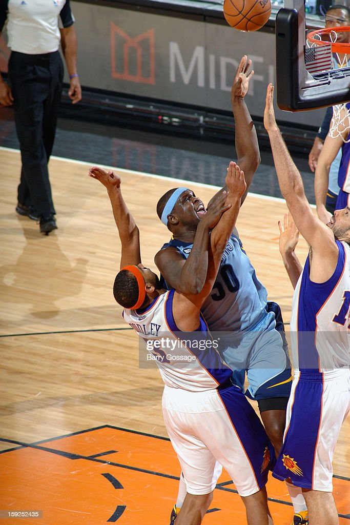 <a gi-track='captionPersonalityLinkClicked' href=/galleries/search?phrase=Zach+Randolph&family=editorial&specificpeople=201595 ng-click='$event.stopPropagation()'>Zach Randolph</a> #50 of the Memphis Grizzlies drives to the basket against the Phoenix Suns on January 6, 2013 at U.S. Airways Center in Phoenix, Arizona.