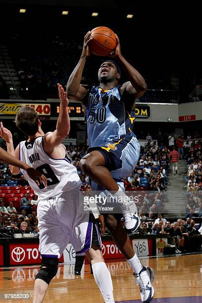 Zach Randolph of the Memphis Grizzlies gets to the basket against Beno Udrih of the Sacramento Kings on March 22 2010 at ARCO Arena in Sacramento...