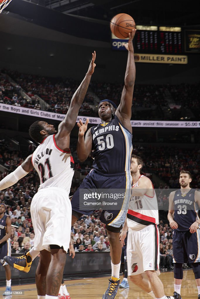 <a gi-track='captionPersonalityLinkClicked' href=/galleries/search?phrase=Zach+Randolph&family=editorial&specificpeople=201595 ng-click='$event.stopPropagation()'>Zach Randolph</a> #50 of the Memphis Grizzlies goes to the basket against J.J. Hickson #21 of the Portland Trail Blazers during the game between the Memphis Grizzlies and the Portland Trail Blazers on April 3, 2013 at the Rose Garden Arena in Portland, Oregon.