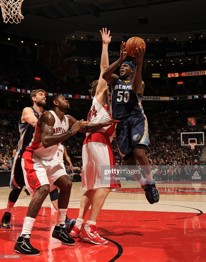 Zach Randolph #50 of the Memphis Grizzlies goes to the basket against Aaron Gray #34 and Amir Johnson #15 of the Toronto Raptors on February 20, 2013 at the Air Canada Centre in Toronto, Ontario, Canada.