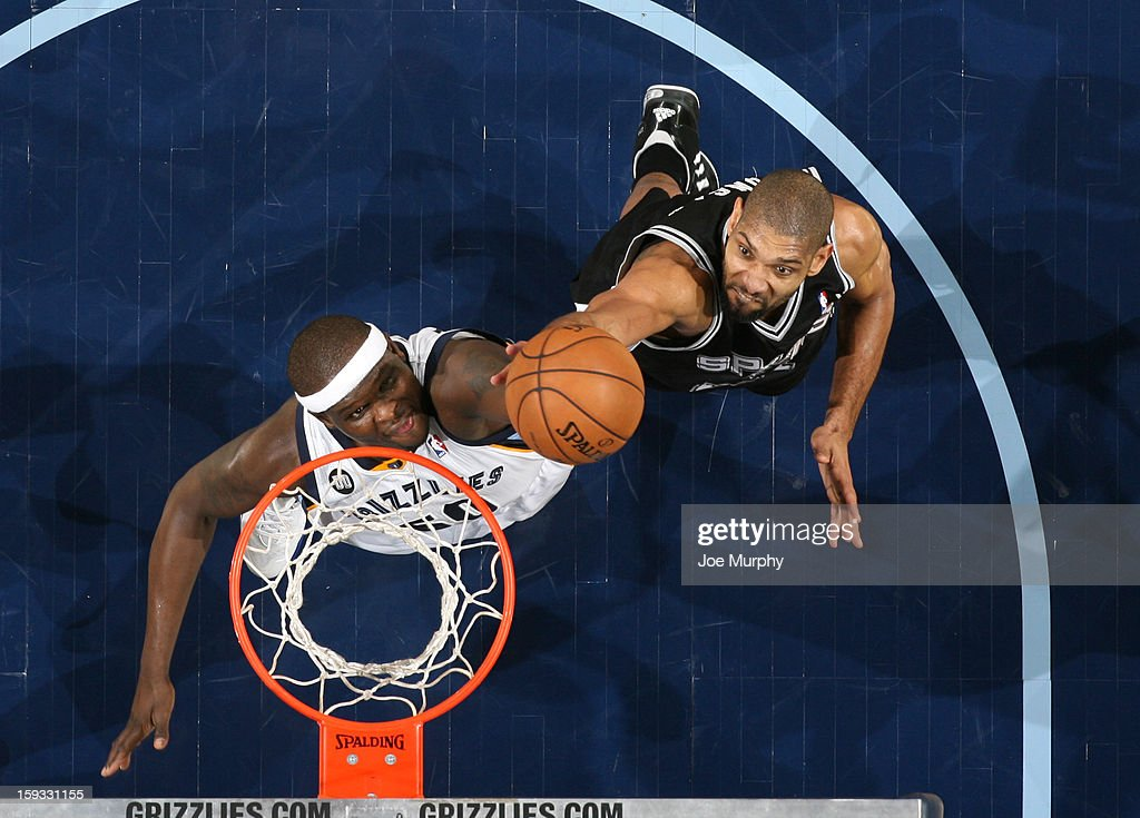 Zach Randolph #50 of the Memphis Grizzlies goes up for a rebound against Tim Duncan #21 of the San Antonio Spurs on January 11, 2013 at FedExForum in Memphis, Tennessee.
