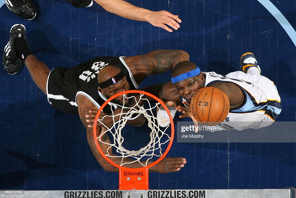 Zach Randolph #50 of the Memphis Grizzlies goes up for a rebound against Reggie Evans #30 of the Brooklyn Nets on January 25, 2013 at FedExForum in Memphis, Tennessee.