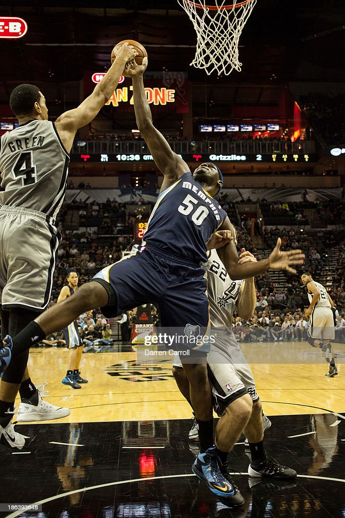 Zach Randolph #50 of the Memphis Grizzlies goes up for a rebound against Danny Green #4 of the San Antonio Spurs during a game on October 30, 2013 at the AT&T Center in San Antonio, Texas.