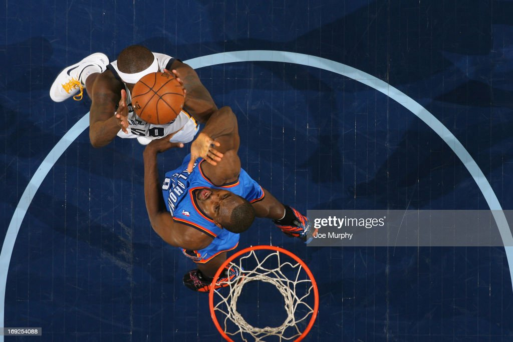 <a gi-track='captionPersonalityLinkClicked' href=/galleries/search?phrase=Zach+Randolph&family=editorial&specificpeople=201595 ng-click='$event.stopPropagation()'>Zach Randolph</a> #50 of the Memphis Grizzlies grabs a rebound against the Oklahoma City Thunder in Game Three of the Western Conference Semifinals during the 2013 NBA Playoffs on May 11, 2013 at FedExForum in Memphis, Tennessee.