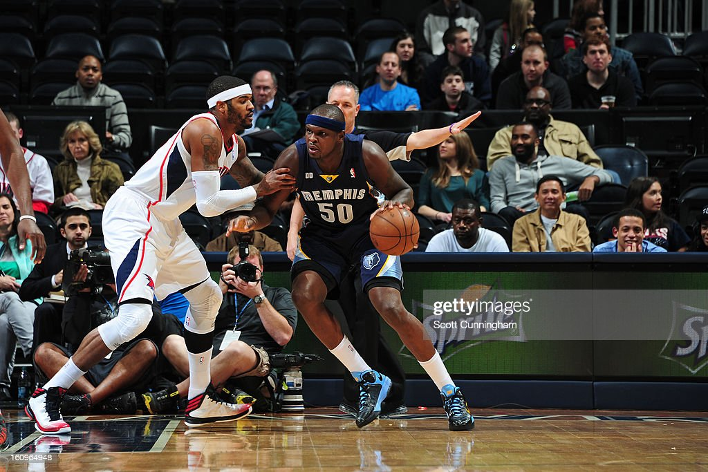 <a gi-track='captionPersonalityLinkClicked' href=/galleries/search?phrase=Zach+Randolph&family=editorial&specificpeople=201595 ng-click='$event.stopPropagation()'>Zach Randolph</a> #50 of the Memphis Grizzlies handles the ball against <a gi-track='captionPersonalityLinkClicked' href=/galleries/search?phrase=Josh+Smith+-+Joueur+de+basketball+-+N%C3%A9+en+1985&family=editorial&specificpeople=201983 ng-click='$event.stopPropagation()'>Josh Smith</a> #5 of the Atlanta Hawks on February 6, 2013 at Philips Arena in Atlanta, Georgia.