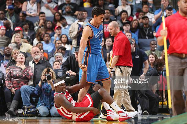 Zach Randolph of the Memphis Grizzlies is helped up by Nick Collison of the Oklahoma City Thunder during the game on November 16 2015 at FedExForum...