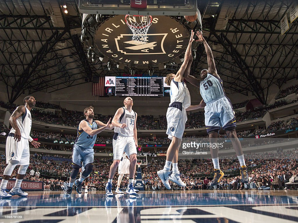 <a gi-track='captionPersonalityLinkClicked' href=/galleries/search?phrase=Zach+Randolph&family=editorial&specificpeople=201595 ng-click='$event.stopPropagation()'>Zach Randolph</a> #50 of the Memphis Grizzlies puts up the hook shot against <a gi-track='captionPersonalityLinkClicked' href=/galleries/search?phrase=Dirk+Nowitzki&family=editorial&specificpeople=201490 ng-click='$event.stopPropagation()'>Dirk Nowitzki</a> #41 of the Dallas Mavericks on January 12, 2013 at the American Airlines Center in Dallas, Texas.