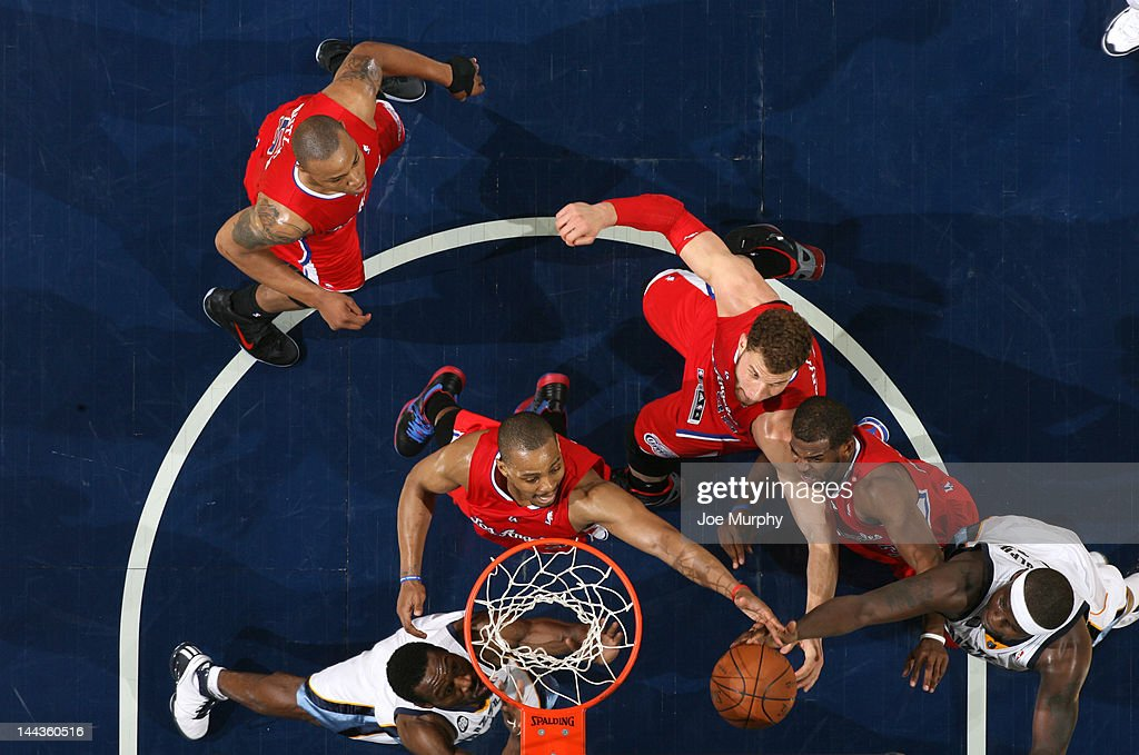 <a gi-track='captionPersonalityLinkClicked' href=/galleries/search?phrase=Zach+Randolph&family=editorial&specificpeople=201595 ng-click='$event.stopPropagation()'>Zach Randolph</a> #50 of the Memphis Grizzlies reaches for the rebound against <a gi-track='captionPersonalityLinkClicked' href=/galleries/search?phrase=Randy+Foye&family=editorial&specificpeople=240185 ng-click='$event.stopPropagation()'>Randy Foye</a> #4 and <a gi-track='captionPersonalityLinkClicked' href=/galleries/search?phrase=Blake+Griffin+-+Basketball+Player&family=editorial&specificpeople=4216010 ng-click='$event.stopPropagation()'>Blake Griffin</a> #32 of the Los Angeles Clippers in Game Seven of the Western Conference Quarterfinals during the 2012 NBA Playoffs on May 13, 2012 at FedExForum in Memphis, Tennessee.