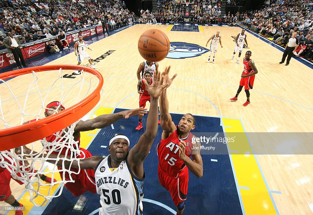 Zach Randolph #50 of the Memphis Grizzlies rebounds against Al Horford #15 and Josh Smith #5 of the Atlanta Hawks on December 8, 2012 at FedExForum in Memphis, Tennessee.