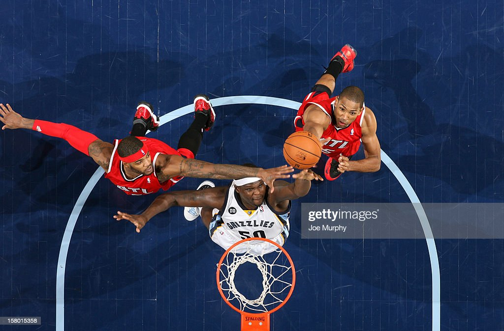 <a gi-track='captionPersonalityLinkClicked' href=/galleries/search?phrase=Zach+Randolph&family=editorial&specificpeople=201595 ng-click='$event.stopPropagation()'>Zach Randolph</a> #50 of the Memphis Grizzlies rebounds against <a gi-track='captionPersonalityLinkClicked' href=/galleries/search?phrase=Josh+Smith+-+Giocatore+di+basket+-+Classe+1985&family=editorial&specificpeople=201983 ng-click='$event.stopPropagation()'>Josh Smith</a> #5 and <a gi-track='captionPersonalityLinkClicked' href=/galleries/search?phrase=Al+Horford&family=editorial&specificpeople=699030 ng-click='$event.stopPropagation()'>Al Horford</a> #15 of the Atlanta Hawks on December 8, 2012 at FedExForum in Memphis, Tennessee.