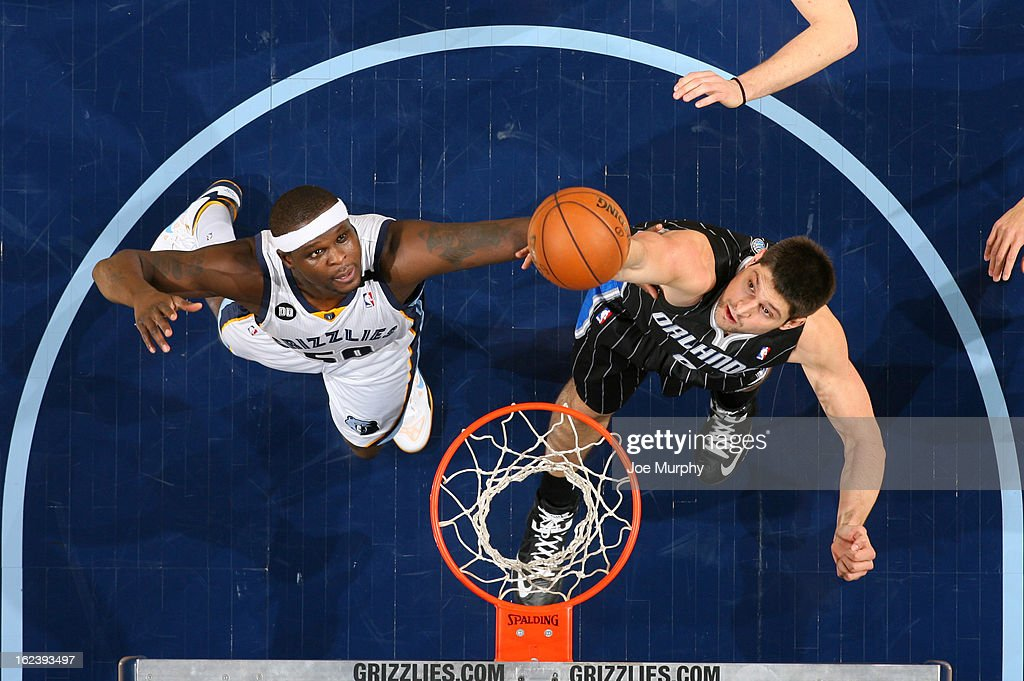 Zach Randolph #50 of the Memphis Grizzlies rebounds against Nikola Vucevic of the Orlando Magic on February 22, 2013 at FedExForum in Memphis, Tennessee.