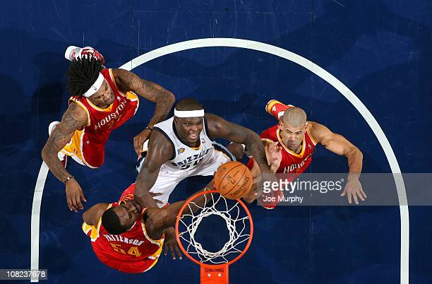 Zach Randolph of the Memphis Grizzlies rebounds against Patrick Patterson Jordan Hill and Shane Battier of the Houston Rockets on January 21 2011 at...