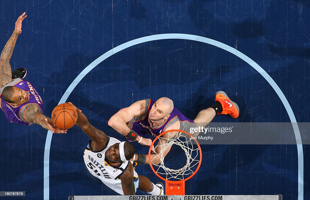 Zach Randolph #50 of the Memphis Grizzlies rebounds against Shannon Brown #26 of the Phoenix Suns on February 5, 2013 at FedExForum in Memphis, Tennessee.