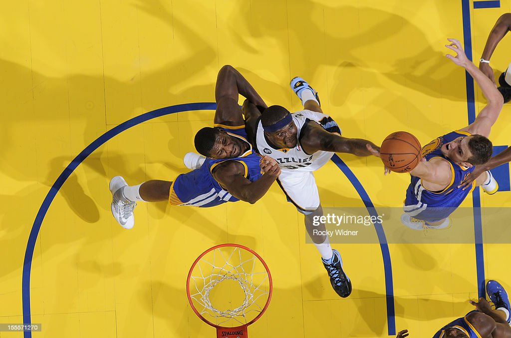 <a gi-track='captionPersonalityLinkClicked' href=/galleries/search?phrase=Zach+Randolph&family=editorial&specificpeople=201595 ng-click='$event.stopPropagation()'>Zach Randolph</a> #50 of the Memphis Grizzlies rebounds the ball against David Lee #10 and <a gi-track='captionPersonalityLinkClicked' href=/galleries/search?phrase=Festus+Ezeli&family=editorial&specificpeople=5725219 ng-click='$event.stopPropagation()'>Festus Ezeli</a> #31 of the Golden State Warriors on November 2, 2012 at Oracle Arena in Oakland, California.