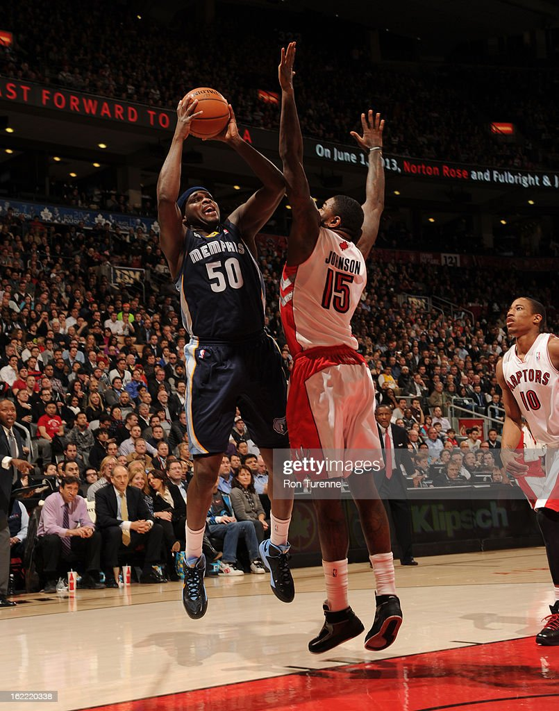 <a gi-track='captionPersonalityLinkClicked' href=/galleries/search?phrase=Zach+Randolph&family=editorial&specificpeople=201595 ng-click='$event.stopPropagation()'>Zach Randolph</a> #50 of the Memphis Grizzlies shoots against <a gi-track='captionPersonalityLinkClicked' href=/galleries/search?phrase=Amir+Johnson&family=editorial&specificpeople=556786 ng-click='$event.stopPropagation()'>Amir Johnson</a> #15 of the Toronto Raptors on February 20, 2013 at the Air Canada Centre in Toronto, Ontario, Canada.